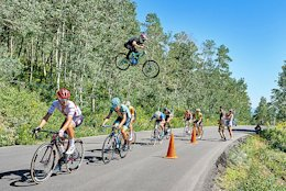 Video: Mountain Biker Gaps the Tour of Utah Road Race