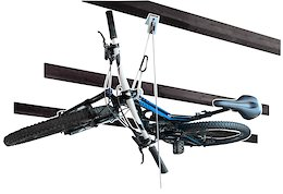 Store your Bike Flat Against your Ceiling with the New Hide-A-Bike System