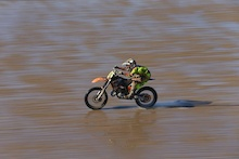 Downhill racers Rich Thomas and Taylor Vernon race the Weston Super Mare MX Beach race