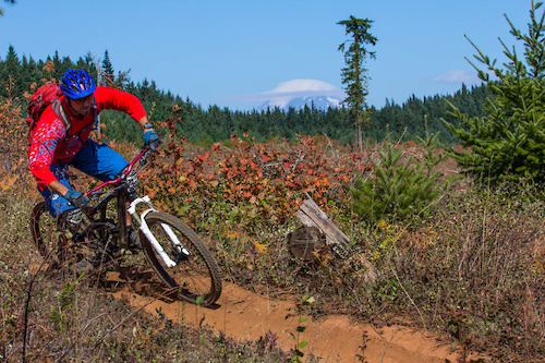 sam riding with mount adams in the background