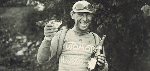 Lucien Buysse, 1926 Tour de France. Celebrating overall victory in Paris.   IMAGES FROM CYCLING'S GLORY DAYS, GOGGLES & DUST.  Goggles & Dust is authored by Shelly and Brett Horton.  Photo Credit @ HortonCollection.com