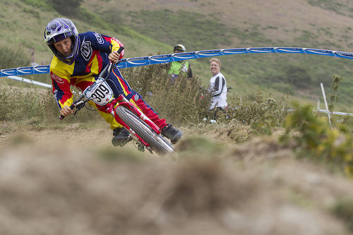 Farther Mark Fernihough watches on as Juvenile rider Harry Fernihough rails a turn during open practice of The Schwalbe British 4X National Championship at Moelfre Hall, Moelfre, United Kingdom. 11July,2015 Photo: Charles Robertson
