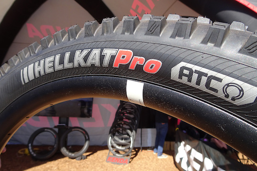 """Kenda Hellkat Pro: This is the trail version of the DH tire Aaron Gwin is now riding. """"AGT"""" (Advanced Gravity Casing) is the designation for the double-reinforced downhill model. This one has the lighter weight ATC (Advanced Trail Casing), which shares the same aggressive tread profile."""