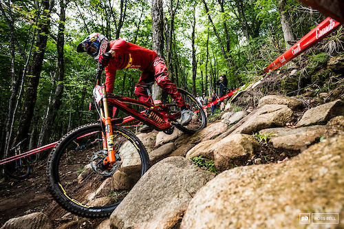 Martin Maes gets to grips with the slippy rocks in the woods.