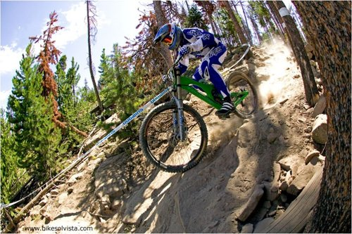 Mike Moga plows through the rocks in Downhill