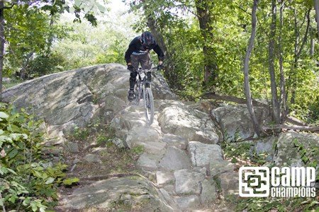 Camper Mitch Hitting a rock line up top