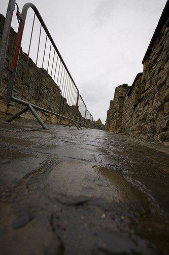 Cobbles, slippery when wet.
