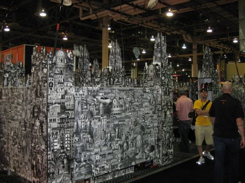 No idea who this was, but their booth kicked ass.  It was put together like a huge 3D puzzle.