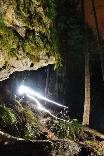 Cam Burnes ripping some dark pacific northwest singletrack on his TransAm