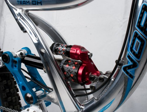 Seat tube and mast around the rear shock