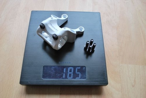185 Grams in the flesh, should be no surprise how many companies weigh their stems without the fixing bolts and sometimes without the four front bolts!