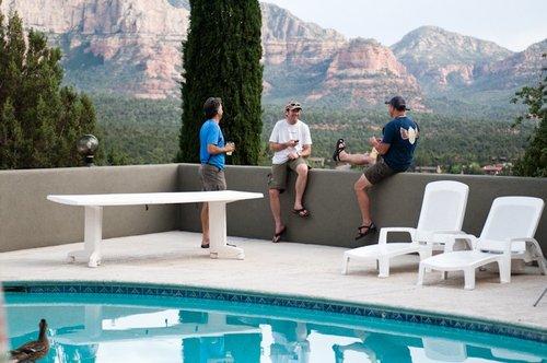 Magura staff lounging poolside