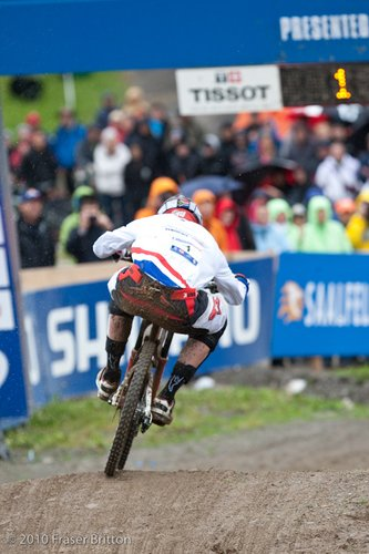 Greg Minnaar rounds the final corner and step down to take the win.