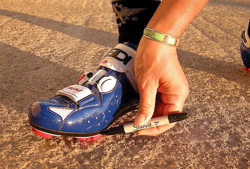 After you locate the ball of the foot through the shoe mark the spot on the sole with a Sharpie pen.