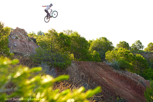 Seek spots, build jumps, shred them. That was the objective of our Europe trip in June. Kirill with one of his early morning stretching exercises ;) suicide nohander on his DMR hardtail. Fell free to check out http://www.facebook.com/LarsScharlPhoto for more!