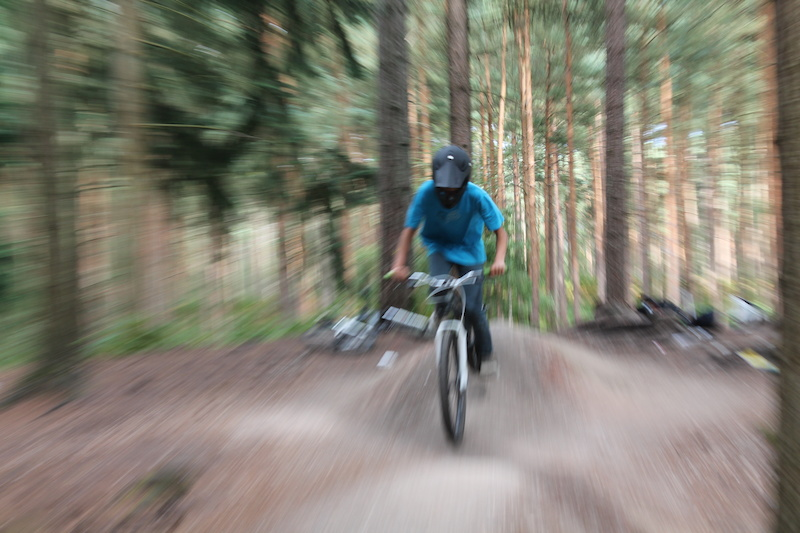 Riding the pump track. Trying a camera technique called zoom burst.