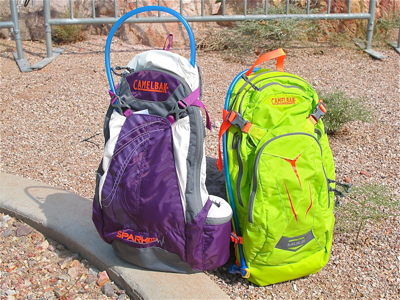 Camelbak s line up of hydration packs covers the widest gamut possible. Here are some fun new colors for the ladies and guys for 2014. The 10L Spark in Imperial Purple Graphite for the girls Left and the M.U.L.E. in Lime Punch for the guys unisex Right