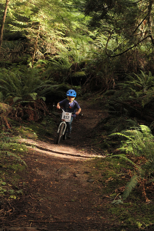 IMBA s Take a kid Mt biking Day Anacortes Community Forest Lands. Ethan coming in hot into a pretty steep section for coaster brakes.
