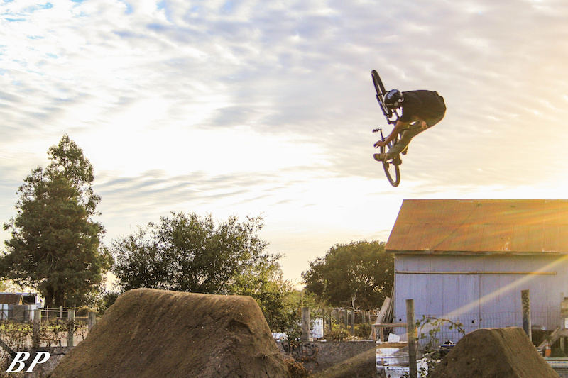 Ray George doing an unturndown into the golden sky of the post office.
