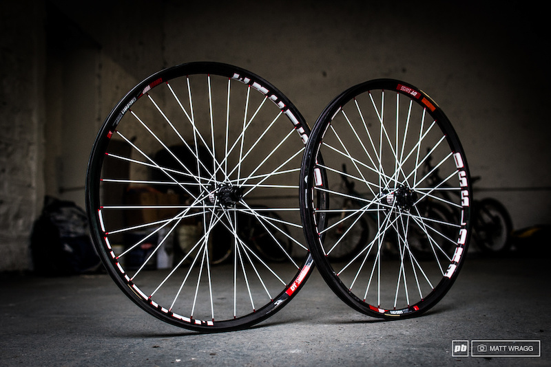 Everything is a matter of taste but for us the matte carbon rims black hubs fat white spokes and red nipples is a winning combination. The net effect is rather flamboyant but if you re laying down this kind of money you don t want something dull do you