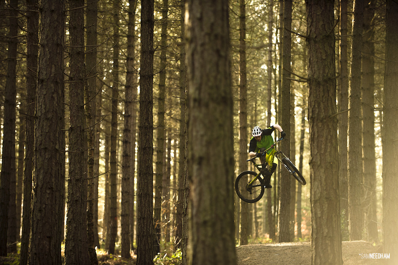 Style for miles. Josh Lewis weaving his bike sideways through the trees of Wharncliffe.