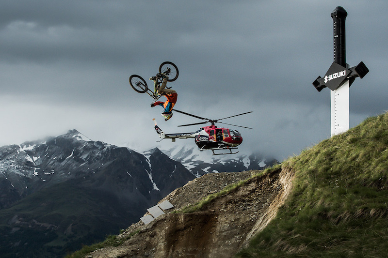 Peter Henke (GER) hitting the massive hip at the bottom of the freeride section of the Suzuki Nine Knights MTB 2014. Sticking his first ever hip flip with his Big Bike Henke is gunning for progression and is one to watch out for at the Contest Day, coming up on Saturday 21st of June.
