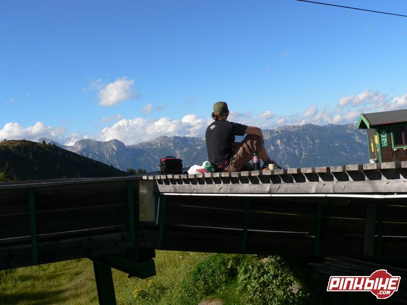 Sipping on wine and eating cheeze while enjoying the beautiful view of Austria.