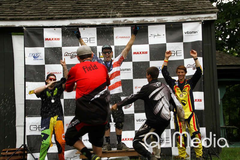 Beer shower on the pro podiums at Launch