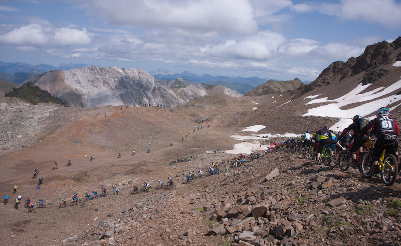The racers are negotiating the famous moon-like terrain of the Rothhorn.