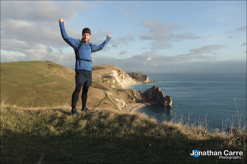 Self portrait of trail running along the South West Coast Path. Bit of a slog up this steep climb but the views back along the coast of Durdle Door made it worth it!
