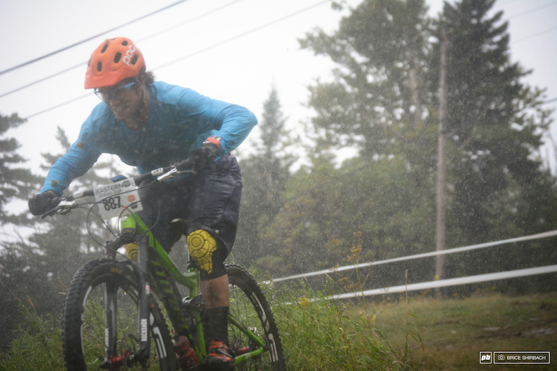 Adam muscles through the sheets of rain en route to a 4th place finish for the pro men.