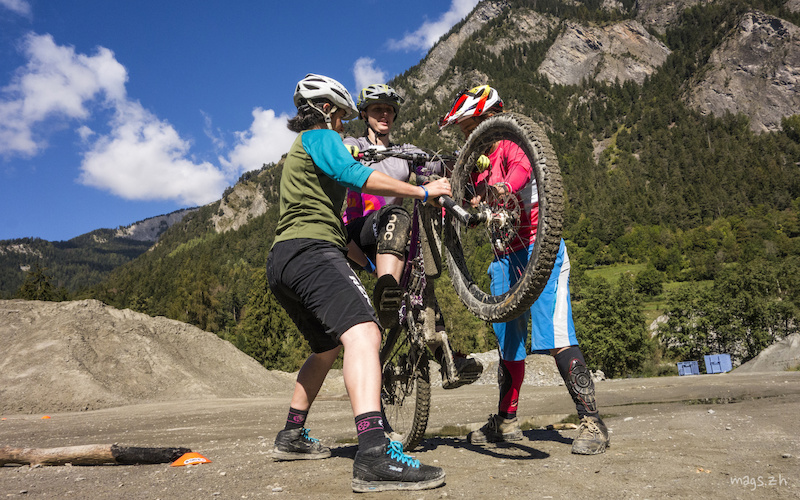 Tracy and Anja help Emma to feel just how high you can lift the front wheel without losing your balance