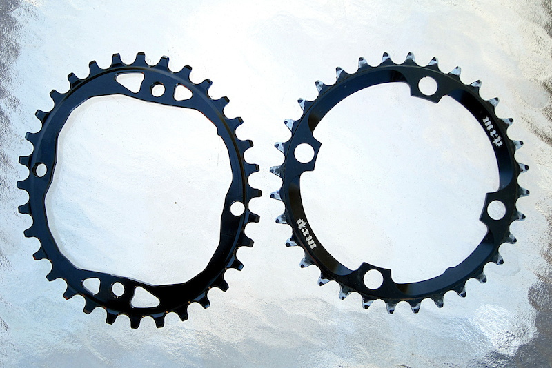 Absloute Black 32t oval chainring beside a 32t MRP round chainring 2014