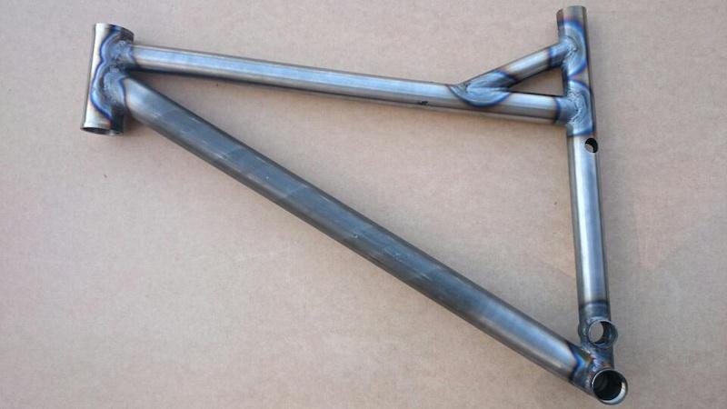 Custom Coiler frame welded. New front triangle steel 4130 CrMo . TT 23mm longer BB 15mm lower. Rocker arm pivot still to be inserted.