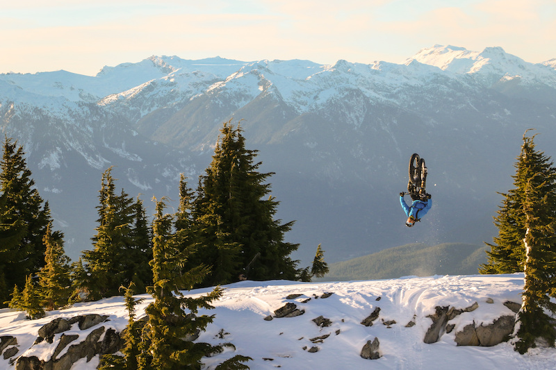 We haven't seen an on-snow fat bike flip before, but we're most surprised that Gully can flip this straight. 