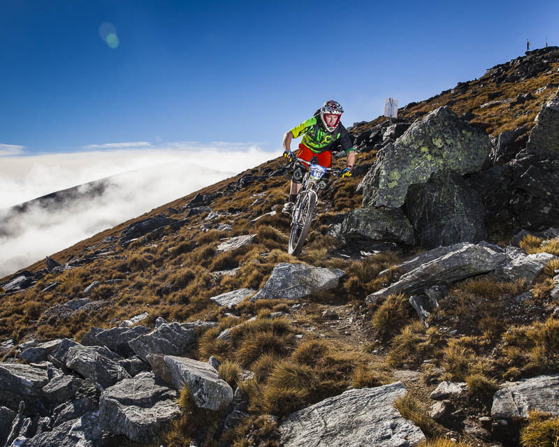 Jimmy Pollard showing why he was the overall winner making this technical section look easy on Race stage D of the 2014 Cardrona 2W Enduro held north of Queenstown, New Zealand.