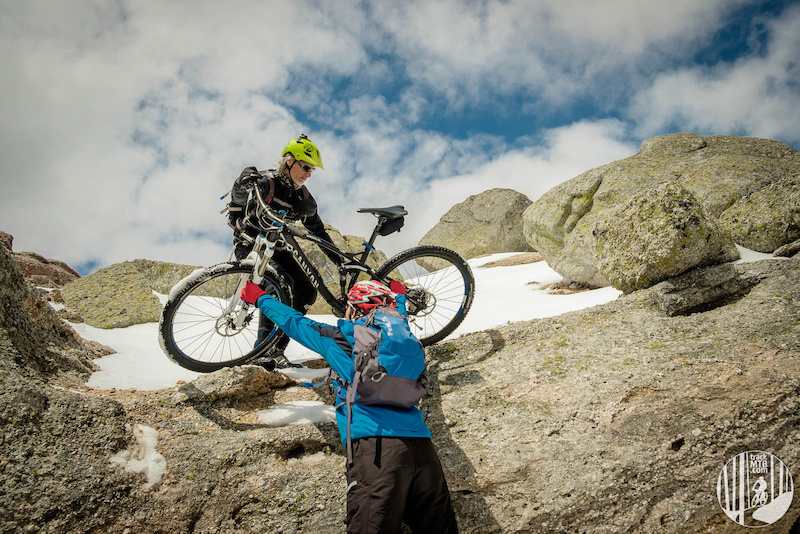 Handling the bikes to reach the top of Pico Urbion