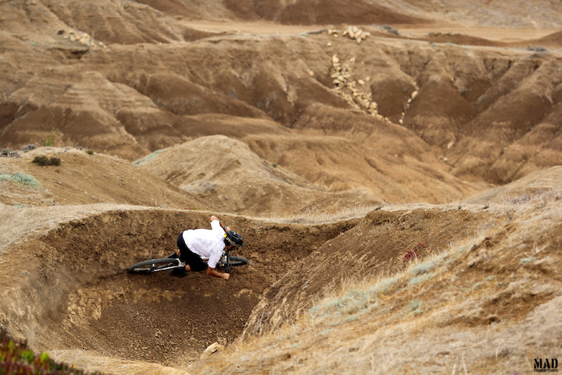 Riding the mini Rampage location with the MADproductions rider, Rui Sousa. Who doesn't love a big natural berm ?
