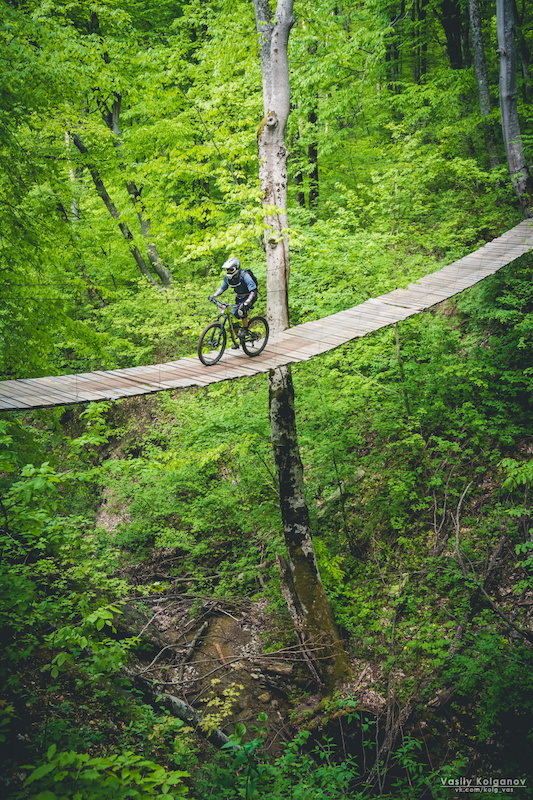 This 35m-long bridge is a part of a timed special stage at enduro race (1st of russian enduro series 2015). And yes, it moves from side to side)