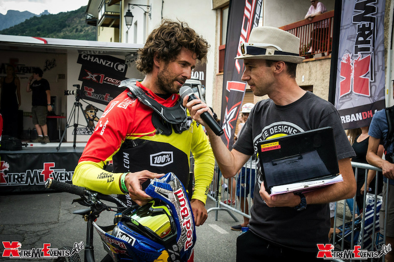 Filip Polc just after this run with the official M.C for the FISE World Crankworx 2 Alpes and Urban DH by Xtrem Events Lionel Beccari
