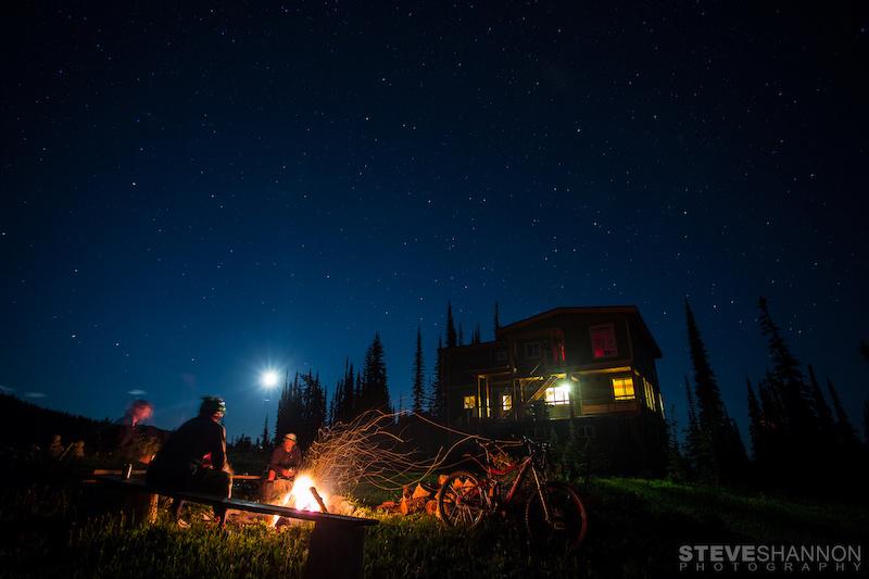 Matt Yaki Jordie McTavish and Rylan Kappler around the fire after a long day of mountain biking at Sol Mountain Lodge in the Monashee mountains.