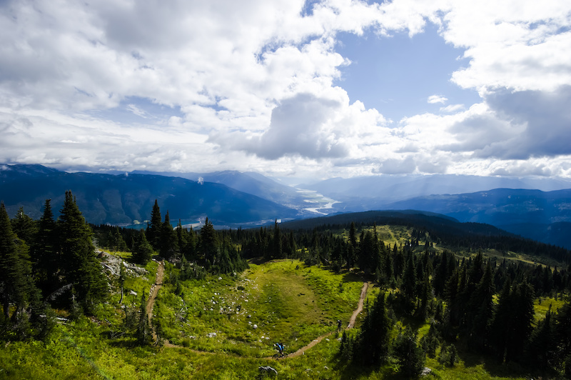 Riders climb the Frisby Ridge Xc Trail overlooking Revelstoke BC. Bruno Long Photo