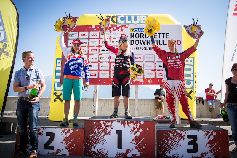 Second placed Elke Rabeder L of AUT event winner Tracy Hannah C of Australia and third placed Simone Wechselberger R of AUT celebrate with their trophies during the the Nordkette Downhill.PRO in Innsbruck Austria on August 29 2015. Photo by Sebastian Schieck.