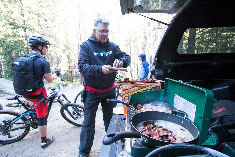 Race curator Keith Darner styles everyone out with some much needed bacon during the long transfer stage.