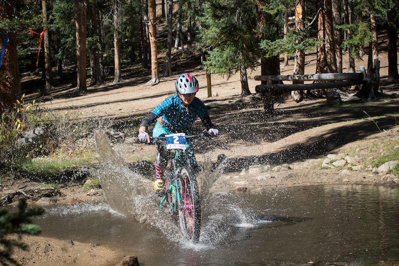 After getting to a semi normal elevation there became many creek crossings. This one in-particular was very refreshing and welcome during such a long stage. Possibly the longest Enduro stage in the world currently. Pro woman 3rd place winner gets wet.