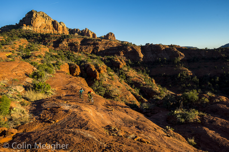 Jason First and Nikki Rohan riding the Hi Line Trail in Sedona AZ. Photo by Colin Meagher