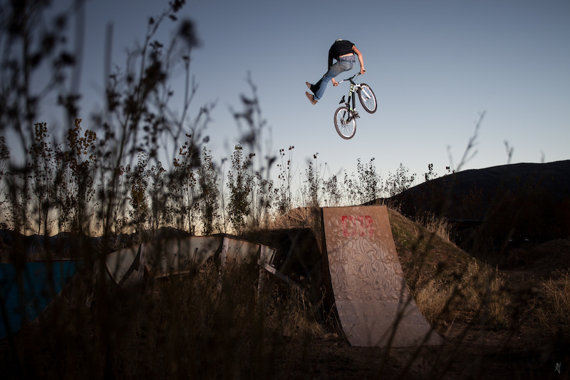 Eric Porter has one of the sickest backyard setups stacked with stunt ramps a pump track and a water slide snake run connected to another pump track in the neighbor s yard.