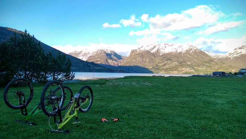 Chilling out at the bottom of the hill ready to cook dinner on the camping stove by the fjord