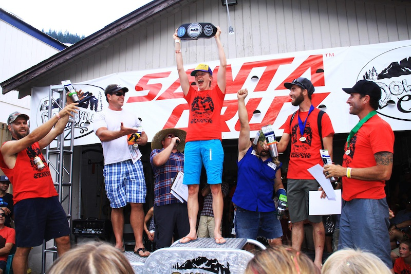Volunteers celebrate victory during the Volunteer Trifecta at the Downieville Classic
