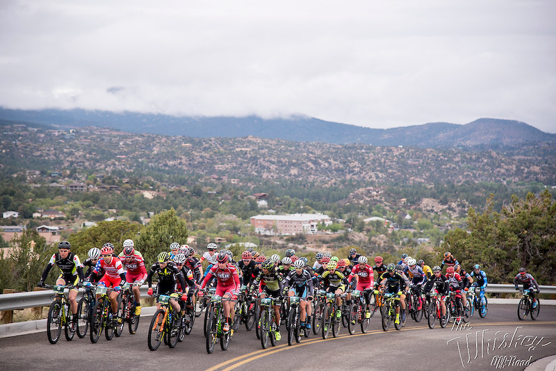 The men s field climbs out of Prescott on pavement.